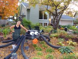 giant halloween spider made from recycled materials diy and