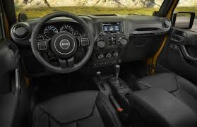 jeep willys 2015 4 door jeep rounds some of the edges off the rugged 2014 wrangler and