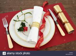christmas dinner table setting with white plates knife and fork christmas dinner table setting with white plates knife and fork linen serviette red