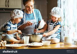happy family kitchen mother children preparing stock photo