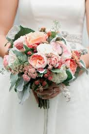 ranunculus bouquet wedding bouquet ranunculus and berry bouquet 2169814 weddbook