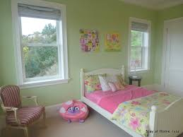 teens bedroom girl bedroom ideas painting lounge chair bedroom baby nursery relaxing little girl s room ideas with green wall paint color pink bedding with green floral duvet nice windows striped chair and cte bedside