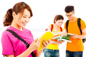 classmates book student read a book with classmates stock photo image