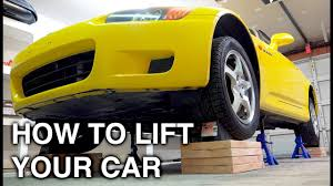 how wide is a two car garage how to completely lift a car on all four jack stands youtube