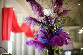 Centerpiece With Feathers by High Table Centerpiece With Purple Long Feathers Blue Flowers