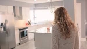 Urban Kitchen Toronto - hispanic woman in a condo in urban toronto shot in 4k sony stock