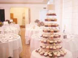 wedding cupcake tower white wedding cupcakes crumbs doilies cupcakes