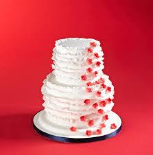 ruffled wedding cake with cascading fondant flowers made using