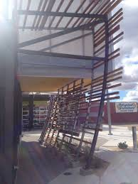 custom vertical steel trellis with wood on store front by steel it