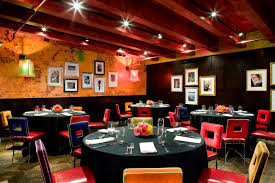 restaurant decor bright colors and art covered walls characterize the decor at latin