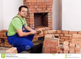 mason building a masonry heater stock image image 31424217