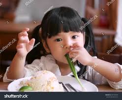 rice table for kids asian children cute kid eating stock photo royalty free