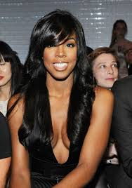 pic of black women side swept bangs and bun hairstyle kelly rowland long black hair style with side swept bangs