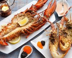 cuisiner homard surgelé recette homards flambés au whisky