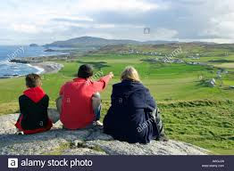 malin head northern family enjoying the panoramic view at malin head in county donegal