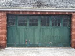 vintage 1950s sliding green garage doors with windows northern