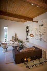modern living room with neutral area rug u0026 concrete floors