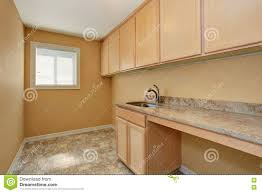 Laundry Room Cabinets With Sinks by Empty Laundry Room With Cabinets With Granite Counter Top And Sink