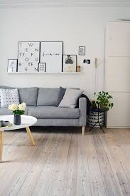 scandinavian living room with grey ikea karsltad sofa and normann