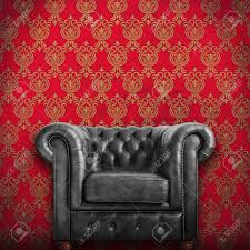 Black Leather Armchairs Classic Black Leather Armchair With Red Wallpaper Background Stock