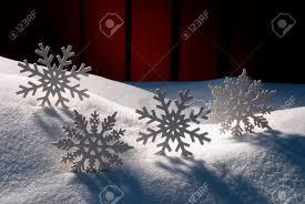 snow decoration four white snowflakes on snow white snowy scenery as christmas