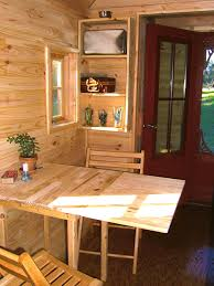 Folding Table With Chair Storage Inside 9 Ways To Live Luxuriously In A Tiny Home Hgtv U0027s Decorating