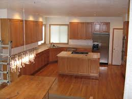 kitchen backsplash ideas with honey oak cabinets travertine tile