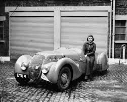 peugeot roadster miss patten baroness dorndorf sits on the door of her peugeot