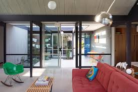 historic eichler home refit for the future nonagon style mid century modern living room design featured with a ceiling window nonagon style