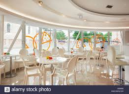 interior of a modern cafe bar white futuristic furniture with