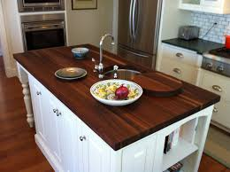 island in small kitchen white cabinets and island in small kitchen dark wooden countertop