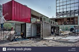 large metal shipping containers in the course of conversion to