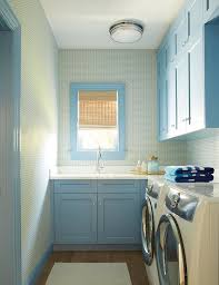 sky blue laundry room with white front load washer and dryer