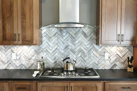 stainless backsplash behind range commercial steel mosaic tile