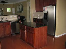 Paint Wood Kitchen Cabinets Brown Paint Wooden Kitchen Cabinet And Island With Black Glossy