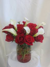 forever roses embrace this luscious bouqet of red roses and calla lilies