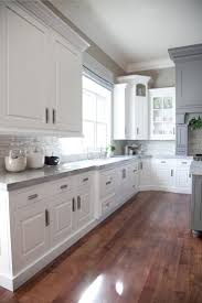 kitchen kitchen backsplash white cabinets dark floors eiforces