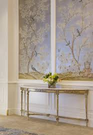 best 25 chinoiserie wallpaper ideas on pinterest powder rooms an elongated demilune gilded table is balanced by the soft sheen of shimmering blue panels