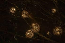 basket spheres lit in tree