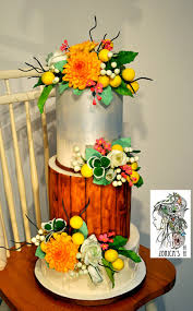 country style wedding cake hand painted middle tier and sugar