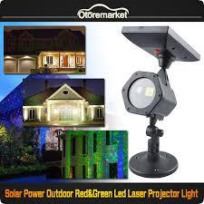 solar christmas light projector solar star laser light projector moving red green dots outdoor