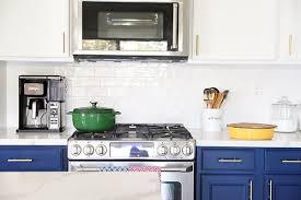 white kitchen cabinets with blue tiles our navy blue and white kitchen remodel no 2 pencil