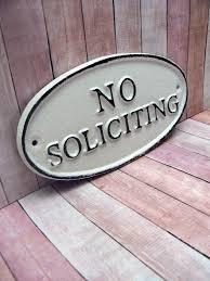 no soliciting cast iron sign shabby chic white wall door home