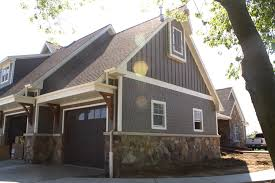 james hardie fiber cement straight edge shake board and batten in two story farmhouse garage with wooden corbels stone accents straight edged shake and vertical