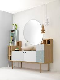 minimalist vanity cabinet and frameless round mirror for