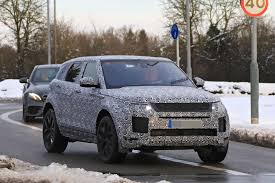 new land rover defender spy shots 2019 range rover evoque velar influence shown with new spy pics