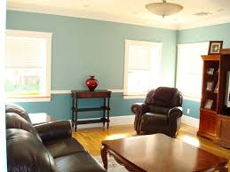 blue wall interior colours for living room with wooden table and