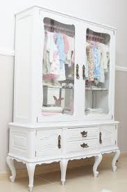 repurpose a vintage china cabinet into a little u0027s clothing