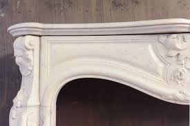 a 19th century french rococo white carrara marble fireplace