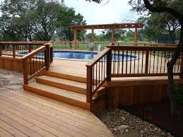 exterior above ground pool which equipped with wooden side deck
